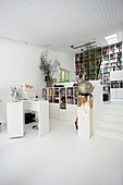 Study and library in open-plan, split-level interior with steps