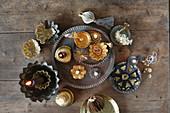 Christmas arrangement of gilt candlesticks and baking tins
