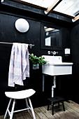 Sink on black wall