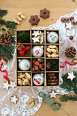 Nuts, biscuits and Christmas baubles in a seedling tray