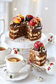 Christmas cake with apples and a cup of tea