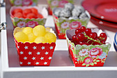Fruit in colourful cardboard bowls