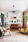 Gallery of pictures in open-plan living room in muted shades