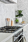 Gas cooker in modern kitchen in shades of grey