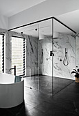 Free-standing bathtub and double shower in bathroom