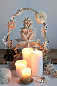 Advent arrangement with a Bascetta star, self-folded from book pages and candles