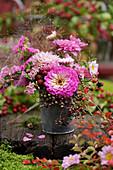 Autumn bouquet of zinnias, yarrow, sea lavender, elderberries, blackberries and chrysanthemums