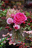 Bouquet of roses, blackberries, hydrangea and everlasting flowers