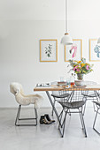 Dining table with classic chairs in a bright room