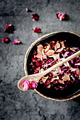 Dried rose petals in a bowl