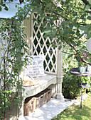Cosy seat in arbour