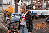 Two women on autumn street