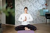 Blonde woman doing yoga
