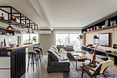 Open-plan interior with seating area and kitchen counter