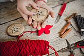 Making Christmas decorations from wooden discs