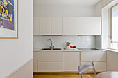 View of white fitted kitchen