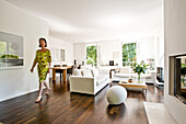 Women walking through modern living area, Hamburg, Germany