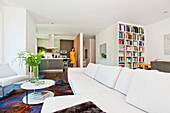 Woman in an open-plan kitchen-living room, Hamburg, Germany