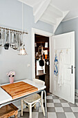 Kitchen furnished in country style, Kitchen utensils hung up, Hamburg, Germany