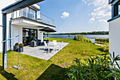 Terrace with water view in a modern architecture style villa, Brandenburg, Germany