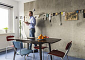 man in a modern prefab apartment in Berlin, Alexanderplatz, Berlin, Germany