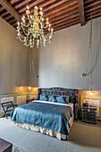 Chandelier over bed in modern hotel room, Guanajuato, Guanajuato, Mexico