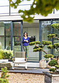 woman at the terrace door with a cup,modern architecture in Hamburg,north Germany,Germany