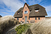 thatched roof house with a modern interior design at the island of Sylt, Schleswig-Holstein, north Germany, Germany