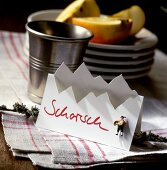 """Alpine style place-card with the word """"Schorsch"""""""