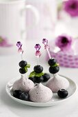 Raspberry meringues with blueberries and lemon balm