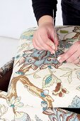 Making an upholstered stool (attaching an upholstery button)