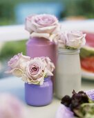 Roses in painted jars