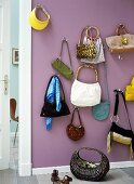 Handbags hanging on a wall