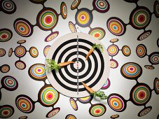 A dart board with carrots