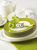 Tableware and green plates with Christmas decorations