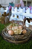 Eggs in hen-shaped basket in Easter nest