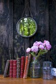 Books, peonies and mirror