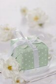 Parcel with white bow and white roses