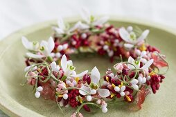 Small wreath of artificial berries & flowers with snowdrops