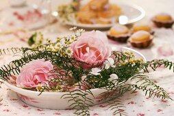 Arrangement of roses, coral fern, horned violets & chamomile