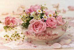 Bowl of roses and chamomile