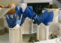 Cutlery holders on a Greek buffet