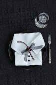 A napkin folded to look like a shirt