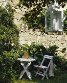 A folding table and chair in a garden