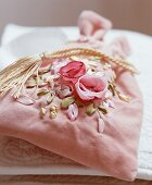A fabric bag with a floral motive (for jewellery)