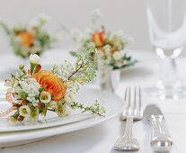 A flower arrangement on a white plate