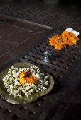 White and orange flowers in a decorative bowl