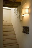Wall lighting in a stairwell with brick staircase