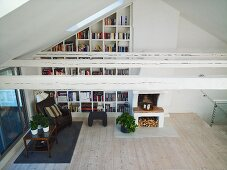 View into a living room with bookshelves in a niche under a ceiling
