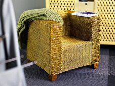 Basket chair with a green throw